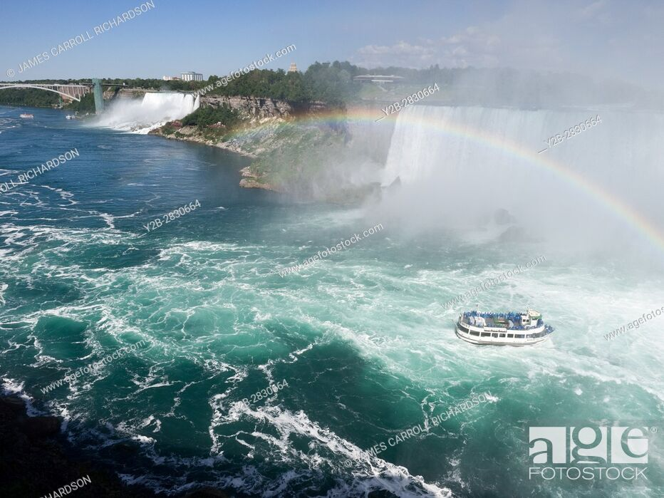 Stock Photo: Sightseeing boat at Niagara Falls on Canadian side with rainbow.