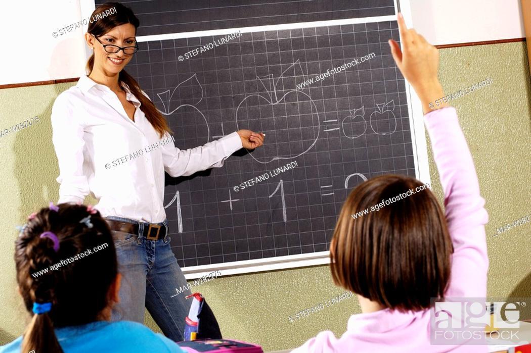 Stock Photo: teacher and little girl, school.