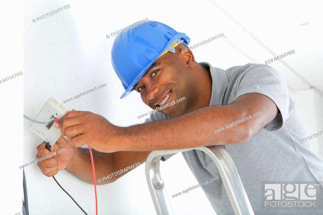 Stock Photo: Portrait of electrician wiring.