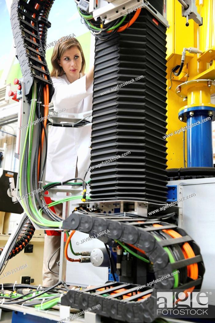Stock Photo: Researcher working on portable robot. Aerospace industry. Technology and Research Center. Miramon Technological Park. San Sebastian. Donostia.