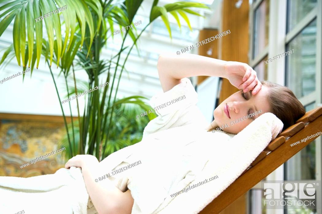 Stock Photo: Woman on deckchair.