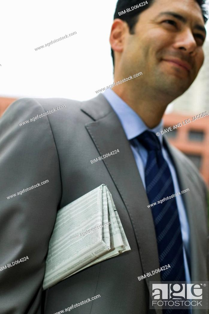 Stock Photo: Mixed race businessman with newspaper.