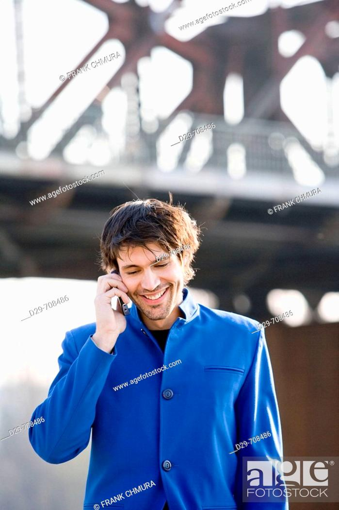 Stock Photo: Man in a suit with mobile phone.