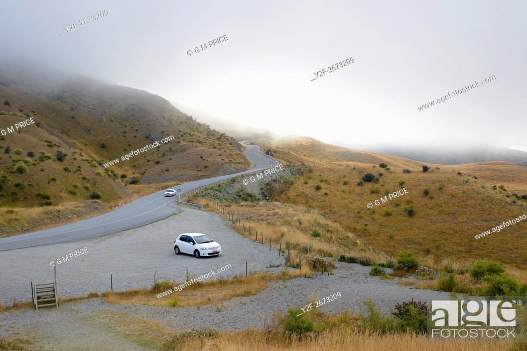 Stock Photo: misty peak road near Queenstown, Otago, New Zealand.