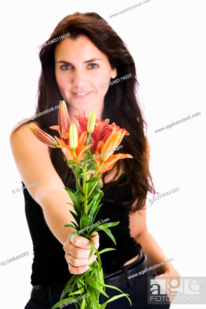 Stock Photo: Portrait of a young woman holding a bunch of flowers.