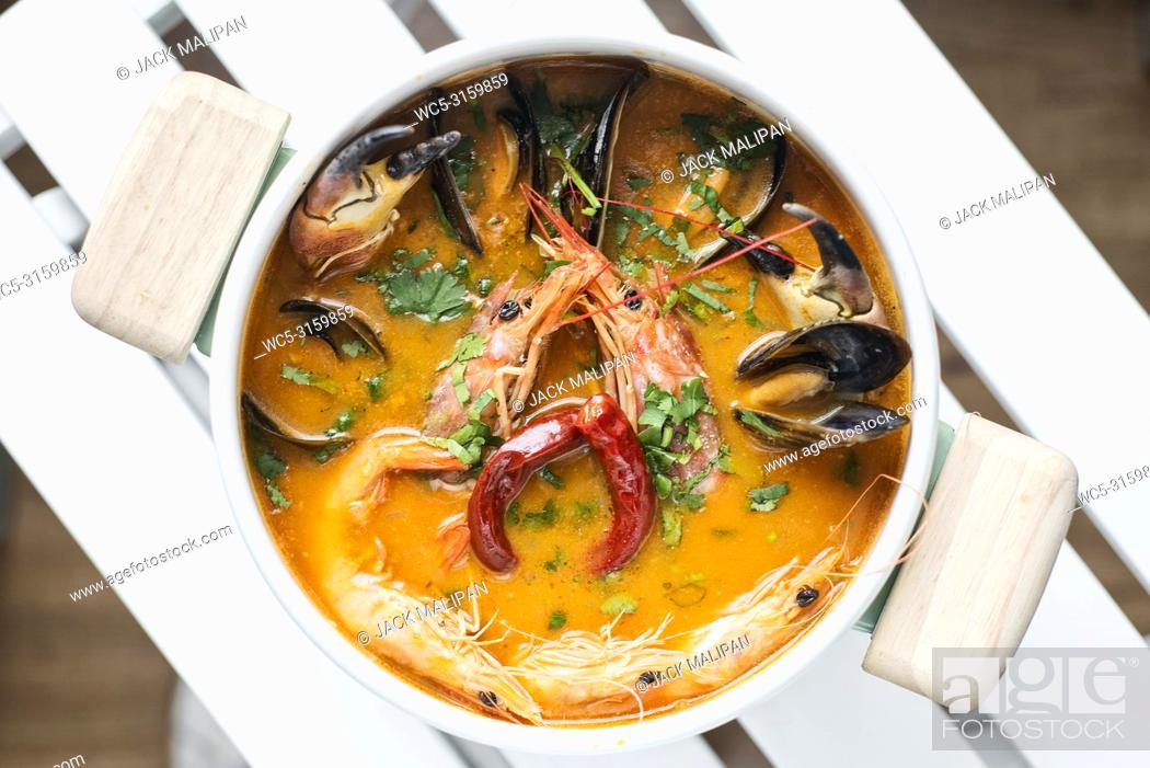 Stock Photo: mixed fresh creamy spicy seafood soup bowl.