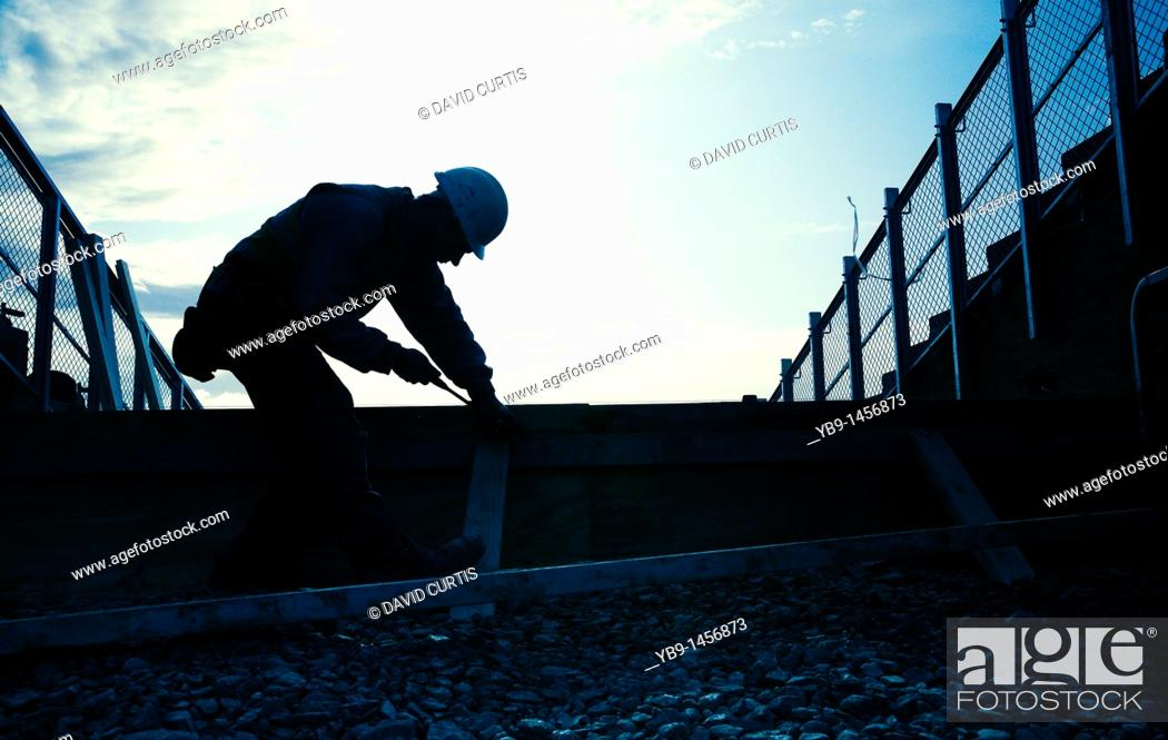 Stock Photo: Silhouette of a Workman.