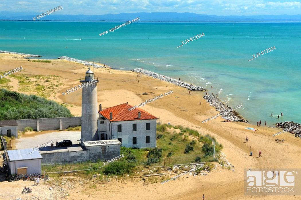 Stock Photo: Aerial view of lighthouse of Bibione. In the background the coast of Friuli.