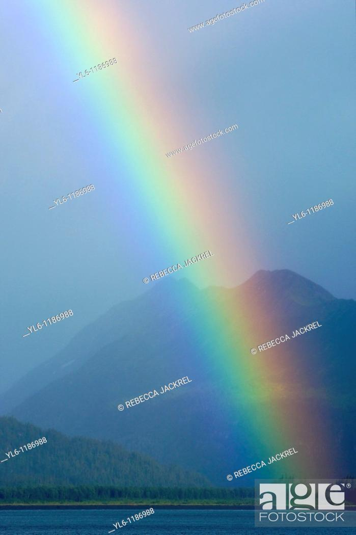 Stock Photo: North America, USA, Alaska, Homer  Rainbow over Kachemak Bay from Homer Spit.