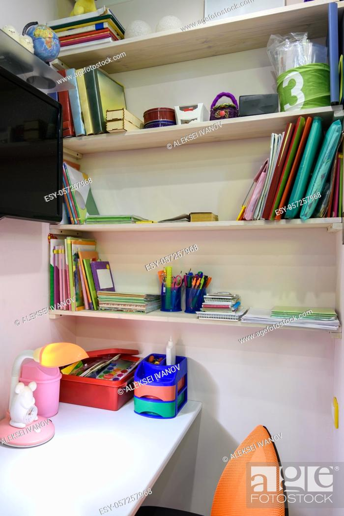 Stock Photo: Writing desk in the children's room, view of the shelves for school books.
