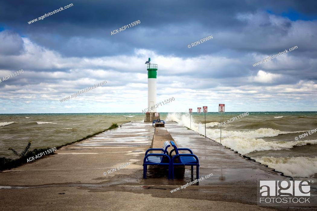 Stock Photo: Waves hitting the pier at the mouth of Parkhill Creek at Lake Huron in Grand Bend, Ontario, Canada.