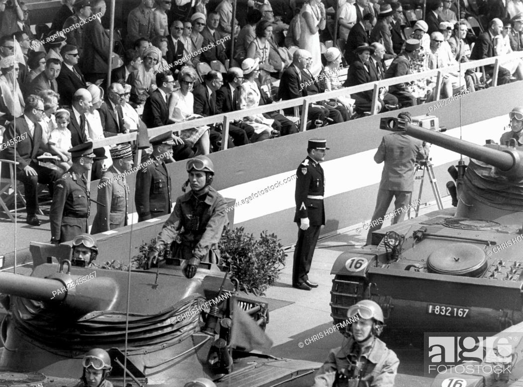 Stock Photo: French tanks driving past a VIP stand during a parade on occasion of the 'Armed Forces Day' on 14th May 1966 in Berlin. To be seen are the three town majors of.