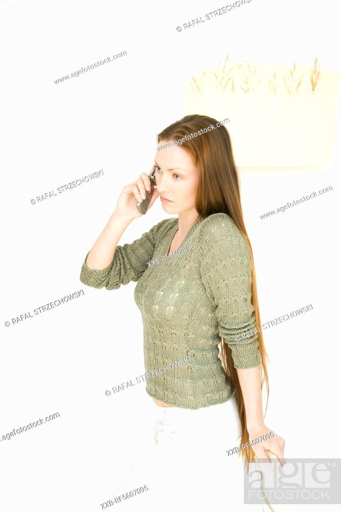 Stock Photo: woman using cell phone.