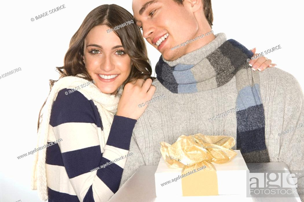 Stock Photo: Young couple holding gifts.