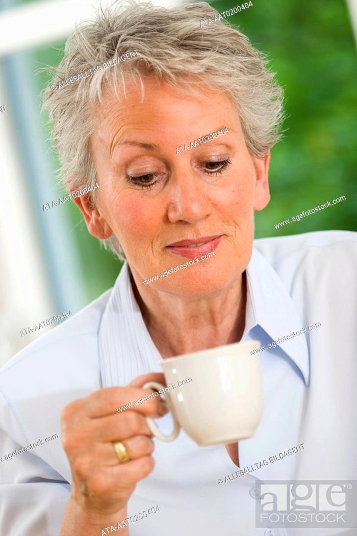 Stock Photo: Older female person drinking coffee.