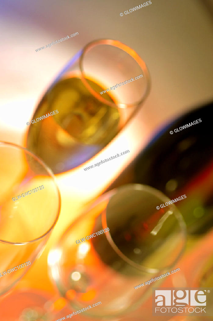Stock Photo: Close-up of a champagne bottle with three champagne flutes.