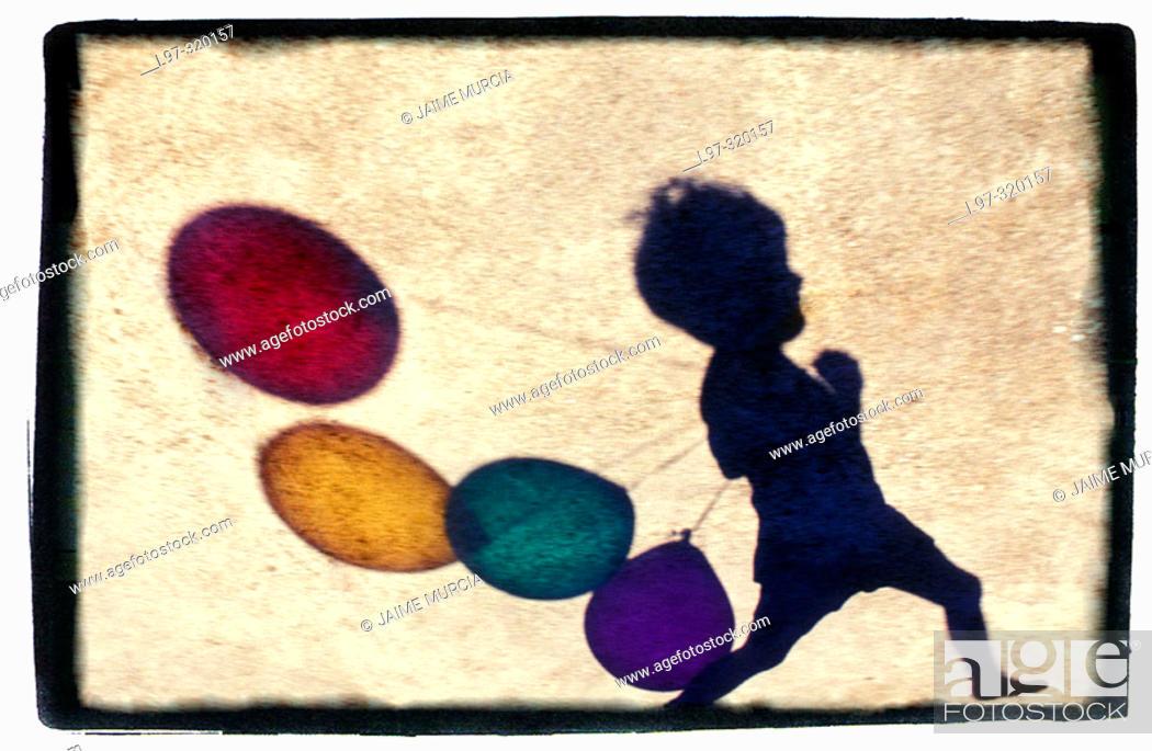 Stock Photo: Balloon silhouette, child running.