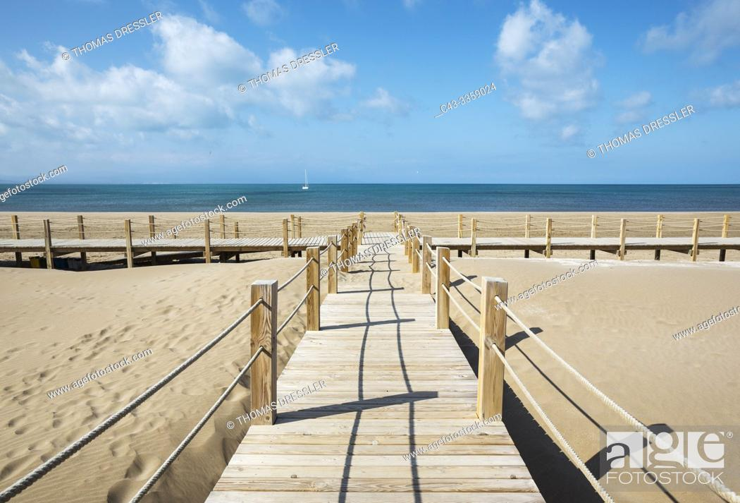 Stock Photo: Wooden footbridges at the beach of Riumar. Environs of the Ebro Delta Nature Reserve, Tarragona province, Catalonia, Spain.