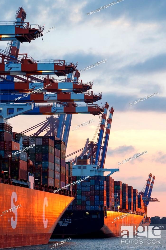 Stock Photo: Ships at the Eurogate and Burchardkai container terminals in the port of Hamburg, Germany, at sunset.