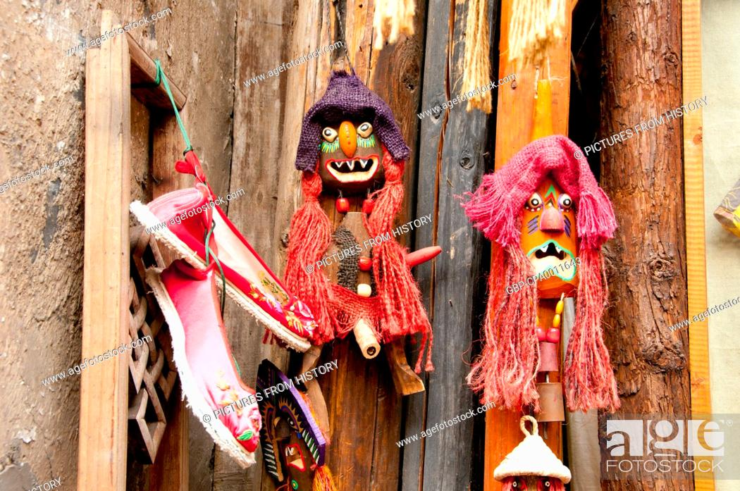 China: Puppets hanging next to a Miao handicraft shop, Fenghuang