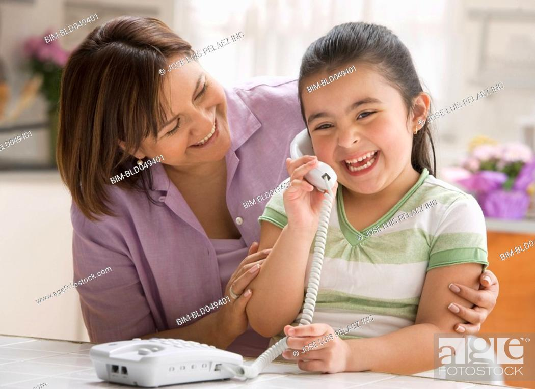 Stock Photo: Hispanic girl talking on telephone.