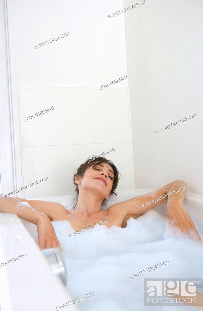 Stock Photo: Woman relaxing in bubble bath.