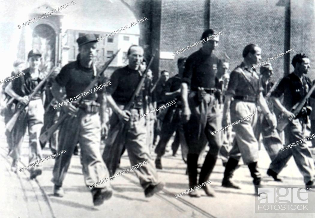 Stock Photo: Photograph of the Black Brigade 'Aldo Resega' parading through the streets of Milan. Dated 20th Century.