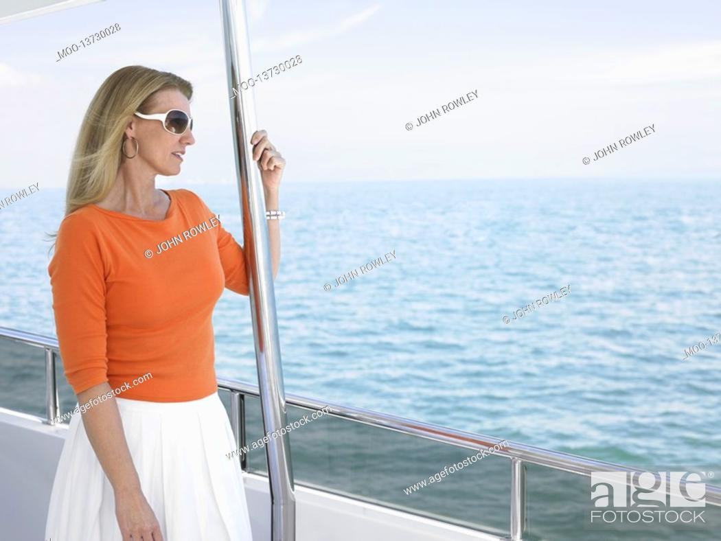 Stock Photo: Middle-aged woman on yacht.