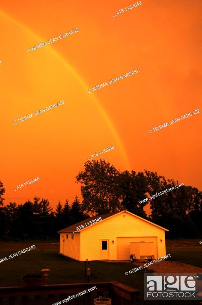 Stock Photo: A double rainbow at sunset in Amherst, Ohio, USA.
