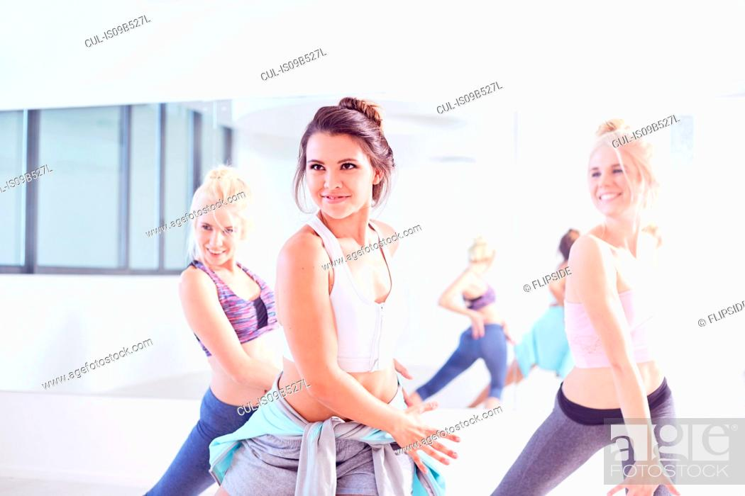 Stock Photo: Young female ballet dancers practicing in dance studio, dancing together.