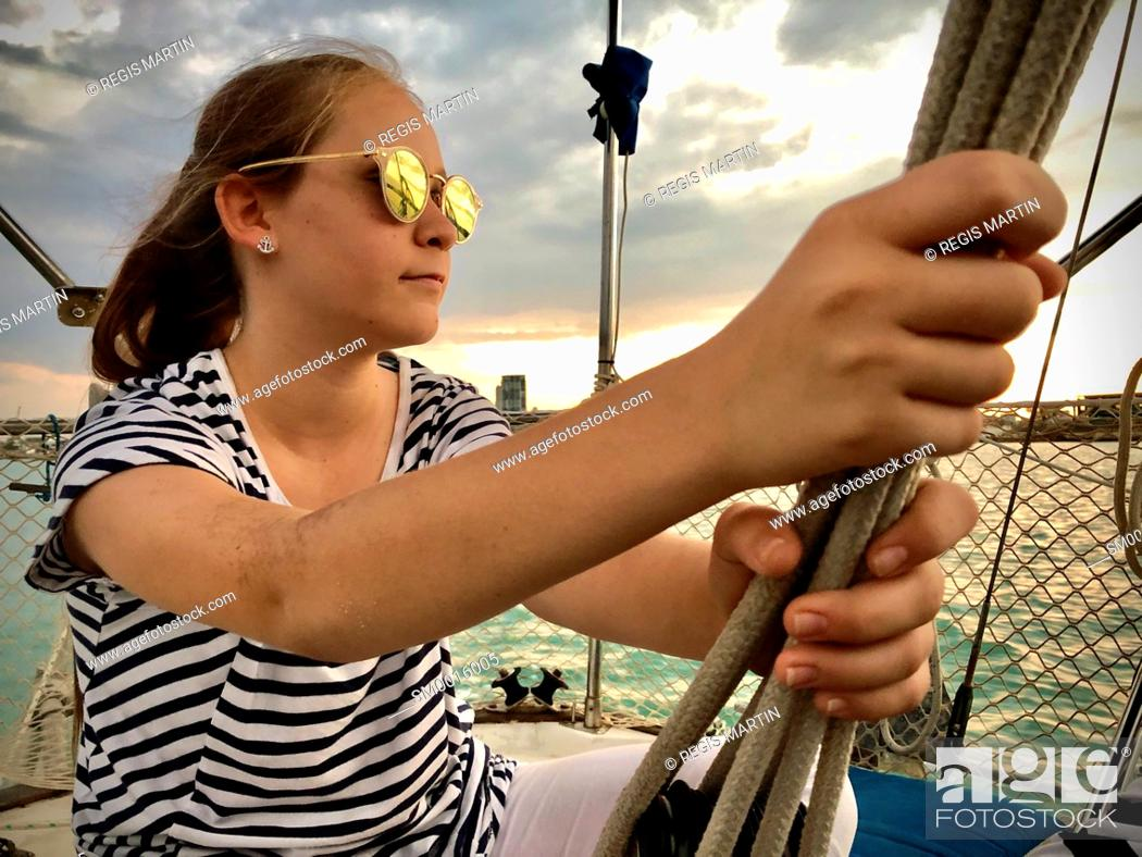 Stock Photo: Young girl on a sailing boat.