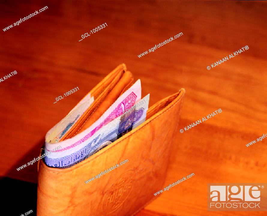 Stock Photo: Wallet with Dirham notes sticking out.