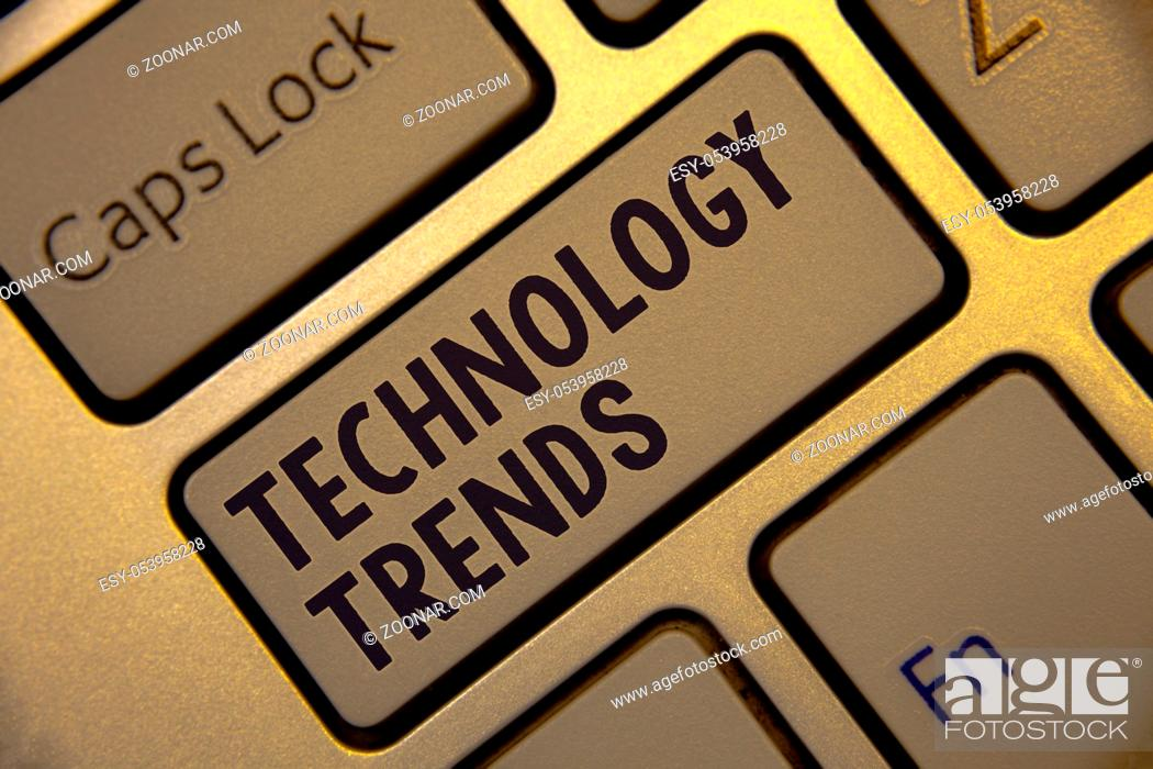 Stock Photo: Handwriting text writing Technology Trends. Concept meaning Trending Modern Viral Advanced Development Trendy New Golden keyboard with jet gray button presents.