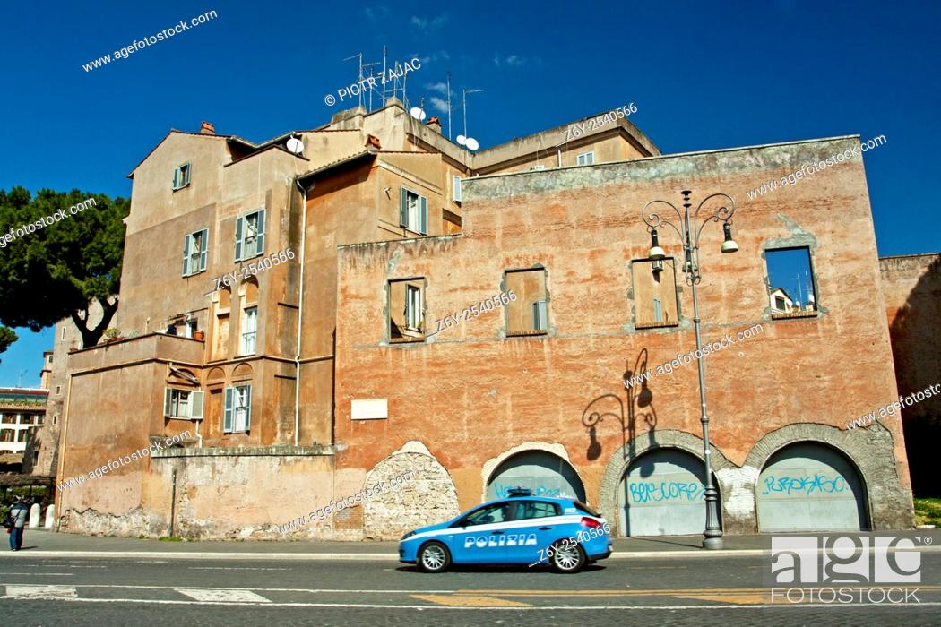 Stock Photo: Police car passing by a building at Via dei Fori Imperiali in Rome, Italy.
