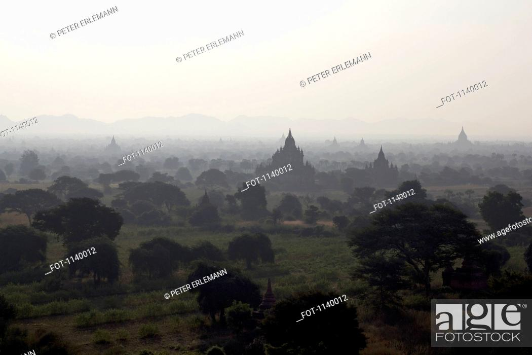 Stock Photo: View of temples of Bagan, Burma spreading out across the landscape.