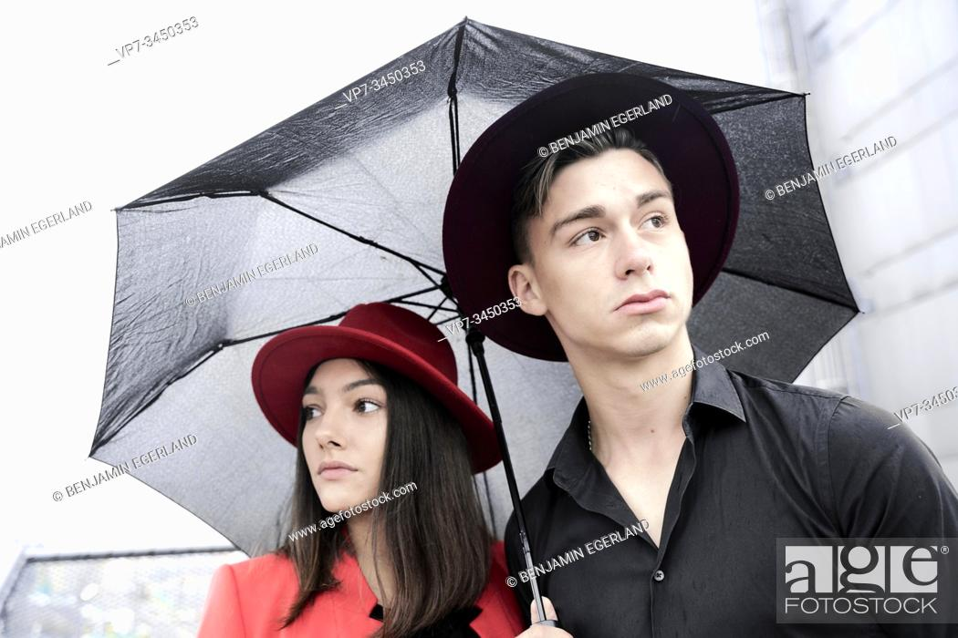 Stock Photo: Young couple under umbrella, Munich, Germany.