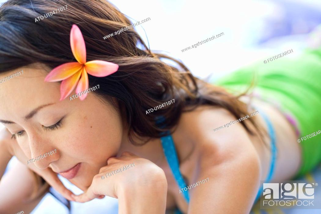 Stock Photo: View of a young woman relaxing.