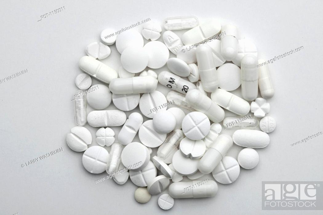 Stock Photo: A heap of various white pills and capsules.