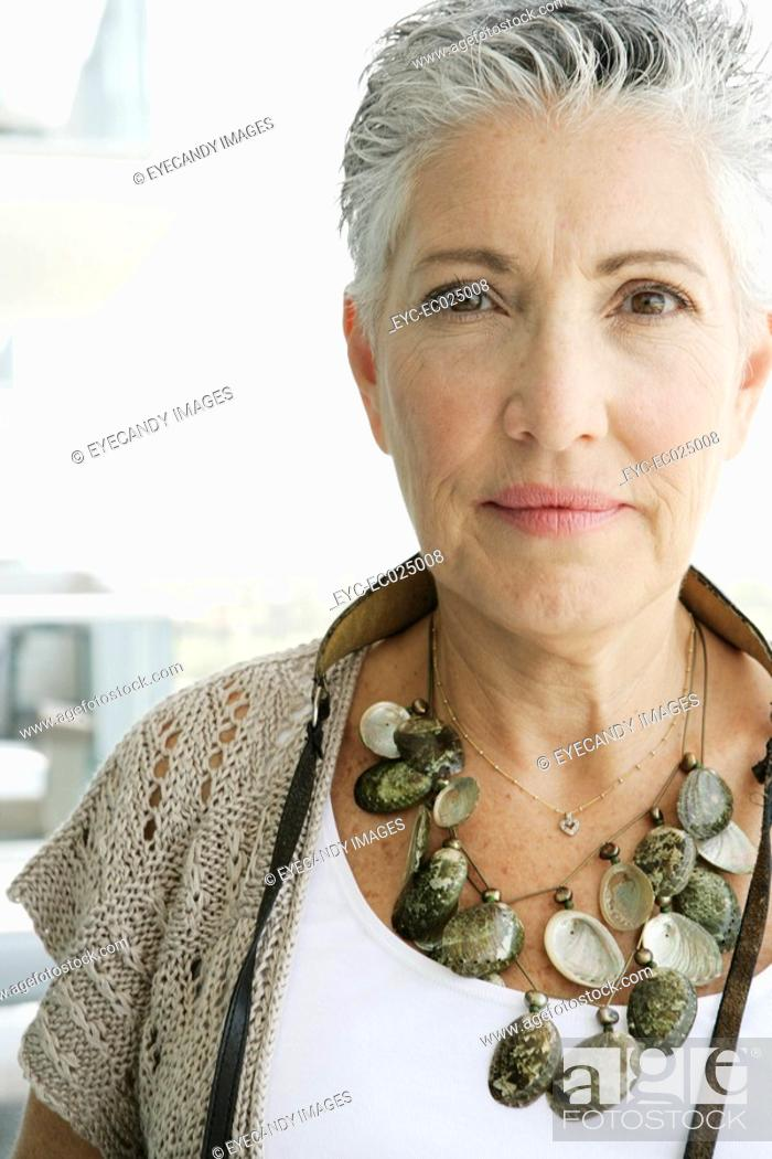 Stock Photo: View of a mature woman looking at camera.