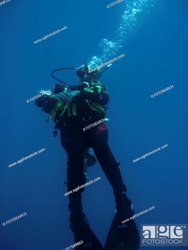 Stock Photo: Diver Looking up at the surface. Sabang. philippines.