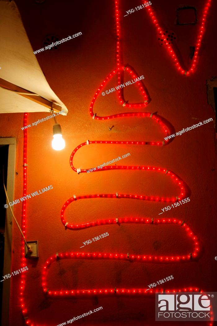 Stock Photo: bright christmas lights on property in city at night.