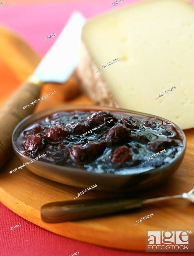 Stock Photo: Ossau-Iraty cheese and dark cherry jam.