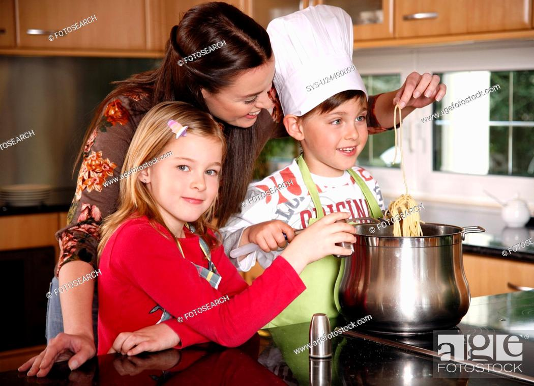 Stock Photo: Mother and children cooking.