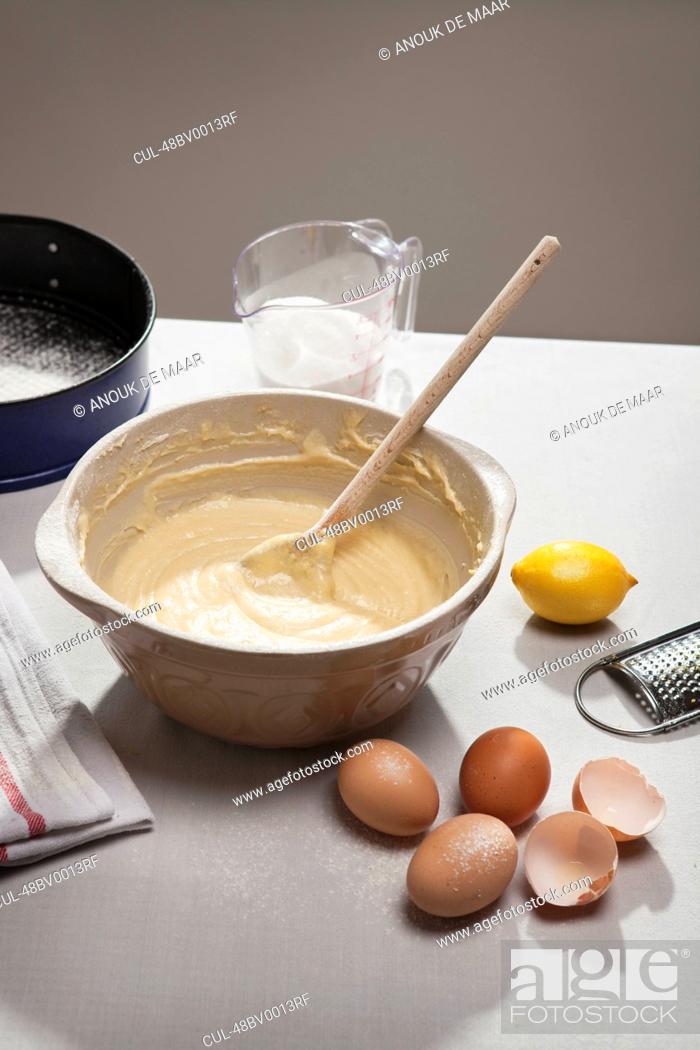 Stock Photo: Eggshells, flour, lemon and batter.