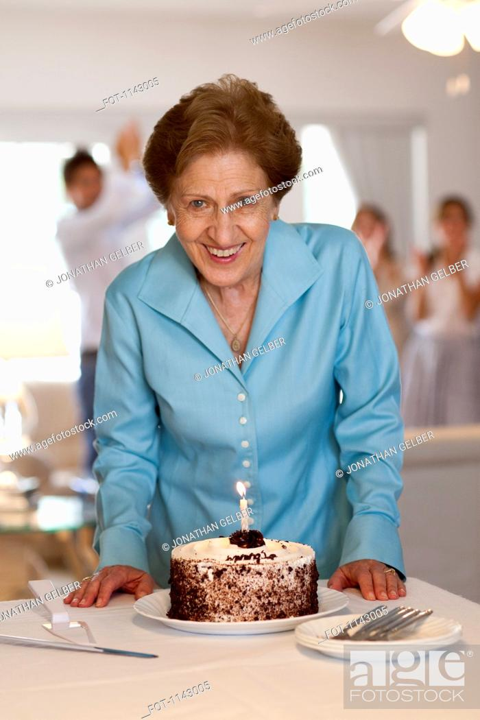 Stock Photo: A senior woman with a cake.