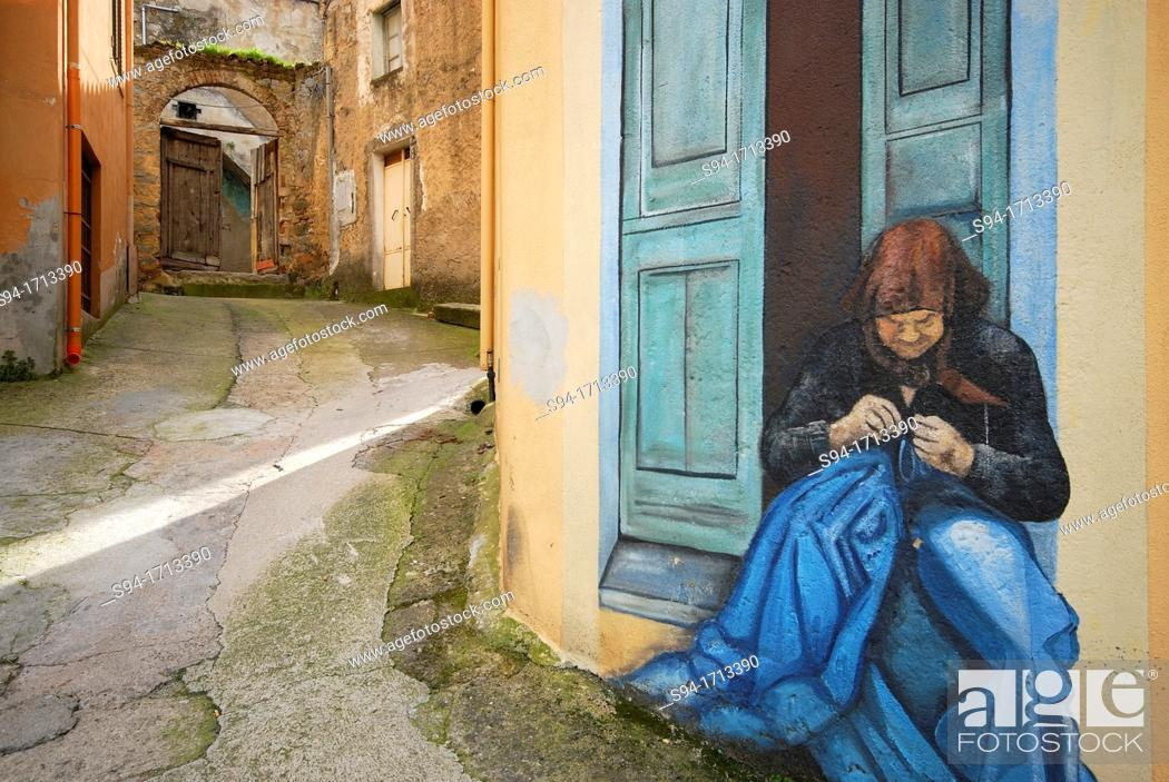 Stock Photo: Mural of a woman in a wall of Orgosolo, Sardinia, Italy.