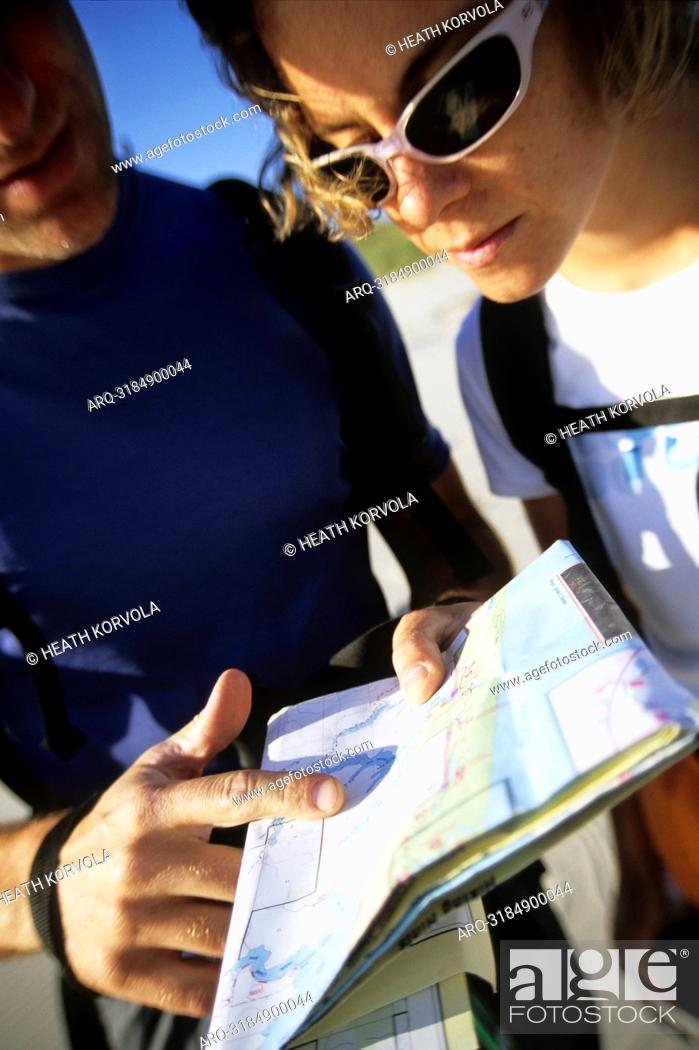 Stock Photo: Hikers reviewing a map during outing in Oregon Dunes National Recreation Area along central Oregon coast.