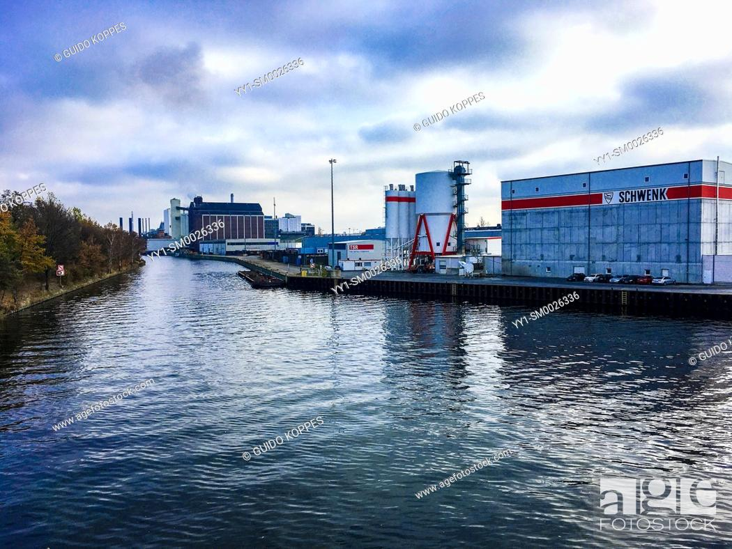 Imagen: Berlin, Germany. View on an Industrial Transport Canal and bordering Industrial Estate Buildings in North-Western part of the German Capitol.