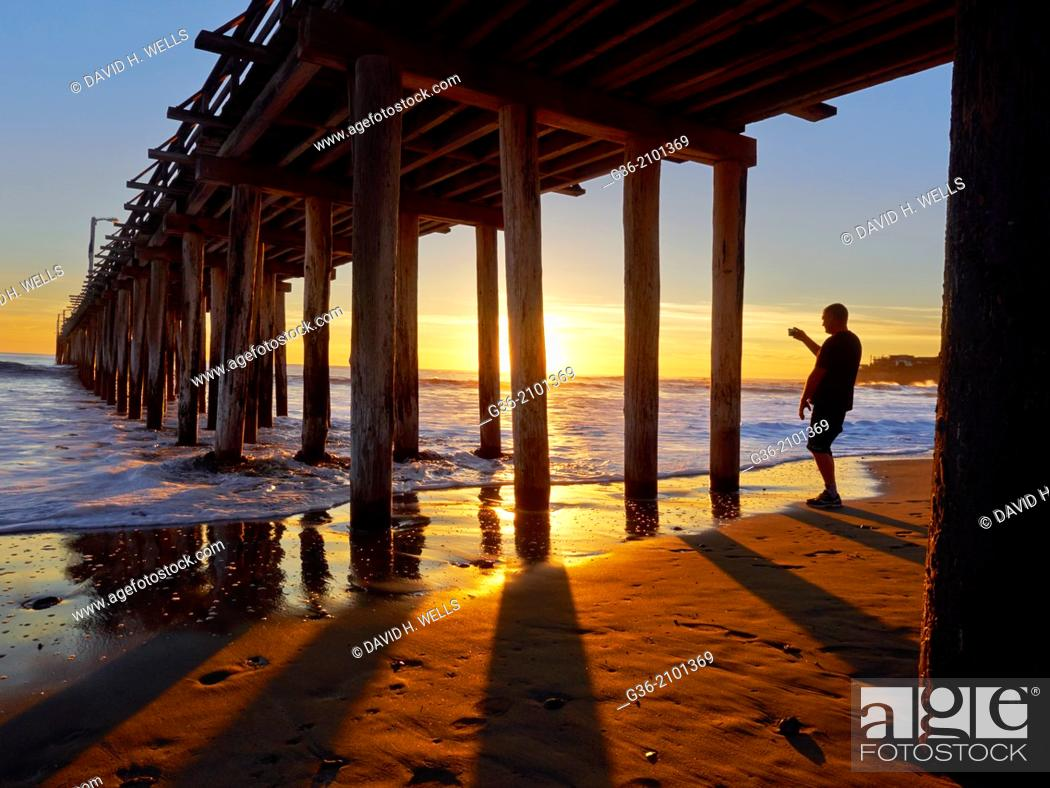 Stock Photo: Silhouette of man at beach during sunset in Cayucas, California, United States.