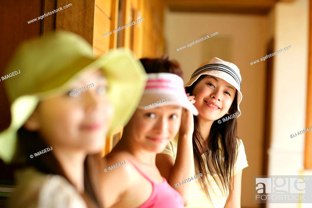 Stock Photo: View of young women smiling.